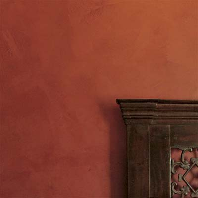example of plaster painting technique with rust colors applied in thick layers with a trowel or putty knife
