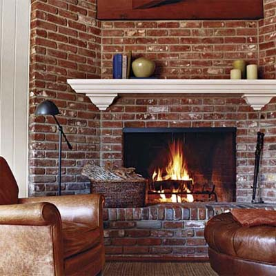 a painted mantel updates the family room's 1950s brick fireplace
