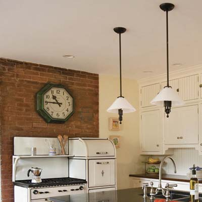 reproduction worktable task lights and an old train station clock