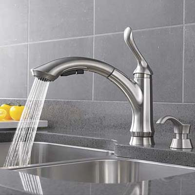 delta liden faucet streaming water into a sink bay