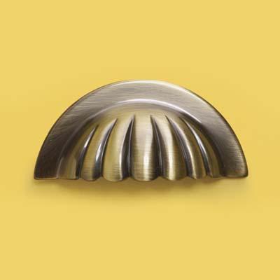a scalloped brass bin pull