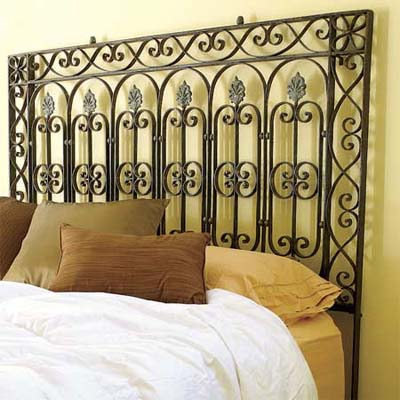 example of a victorian era wrought iron fence turned into a decorative headboard