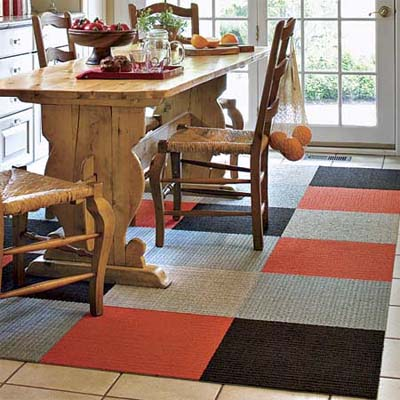 lovely kitchen with colorful geometric carpet beneath the table