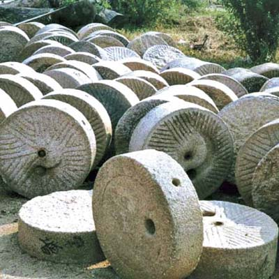 field of sandstone mill wheels available for use as garden ornaments, tabletops or more