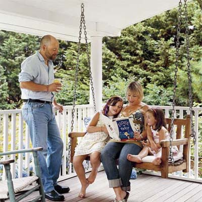 family enjoying the new side porch added to their cottage home