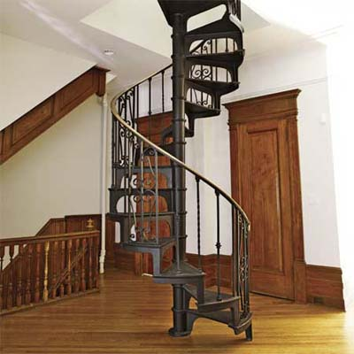 salvaged spiral staircase installed on open landing area 