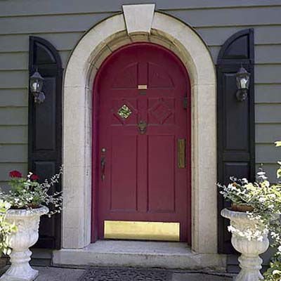front entrance door with a sconce installed on either side