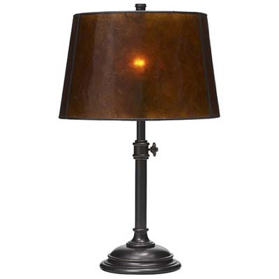 brass lamp capped with colored shade