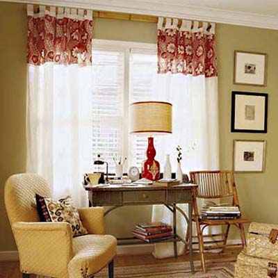 drapes hung at ceiling height giving the illusion the windows are larger