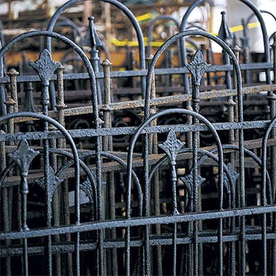 stack of iron fencing that could be used as a fireplace screen