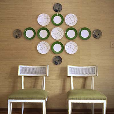 group of plates arranged in a large pattern on a wall