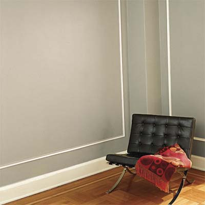 corner of a room with walls and trim painted in contrasting colors
