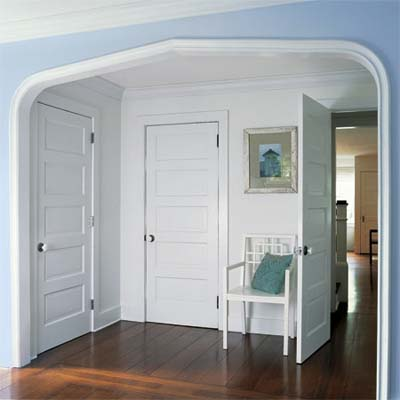 dressing area in the master bedroom built under an archway replicated from the entry hall downstairs