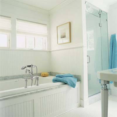 victorian style tub and old fashioned details decorate this modern master bath