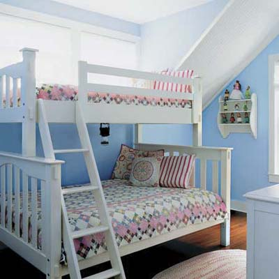 kid's upstairs bedroom with bunkbeds under nestled under a slanted ceiling