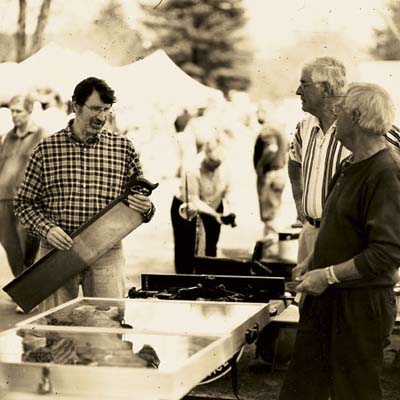 norm talking to two vendors at the brimfield antique show in massachusetts