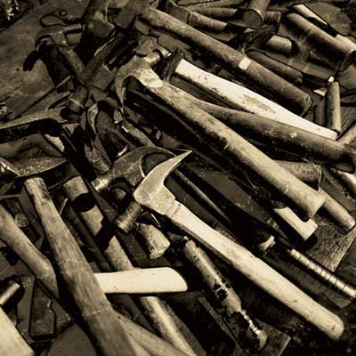 a pile of antique hammers from the brimfield antique show in massachusetts