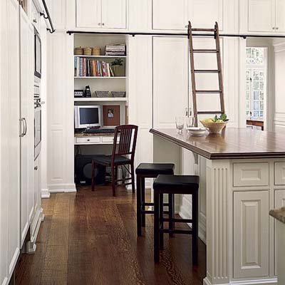 50 linear feet of upper cabinets provide storage for infrequently used kitchen gear