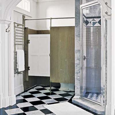 Bathroom with marble tiles and tall ceilings in former post office