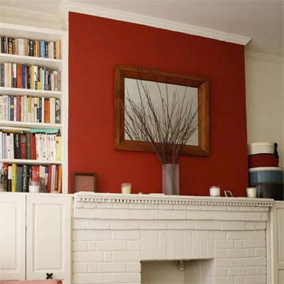 Painting one wall in a room red adds a pop of active color