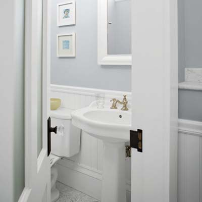 pedestal sink and toilet seen from hallway