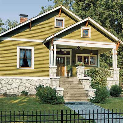terra cotta color exterior paint craftsman house with double hung wood window styles