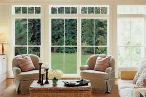 large windowed doors looking out from a living room onto a lawn