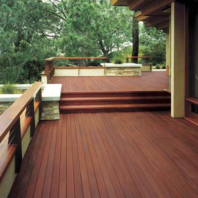 large deck with burgundy-tinted stain from Behr