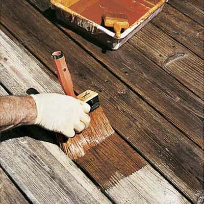 hand staining deck with a large brush