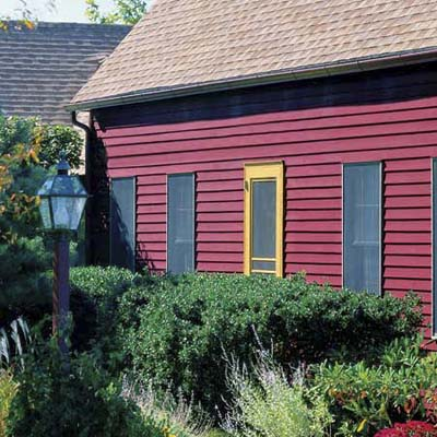 house with stained red siding