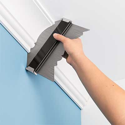 specialty tool being used to create a template to duplicate crown molding