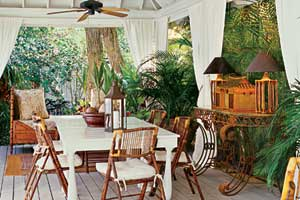 a covered patio with British Colonial style furnishings
