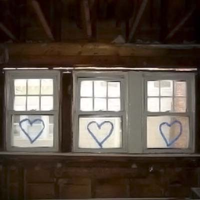 windows with heart shapes decorate the garage of heart house