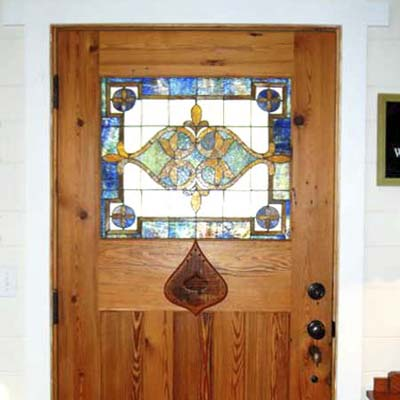 heart shaped stained glass and wood inlay on front door