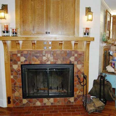 fireplace surround with handmade clay tiles and arts and crafts mantel