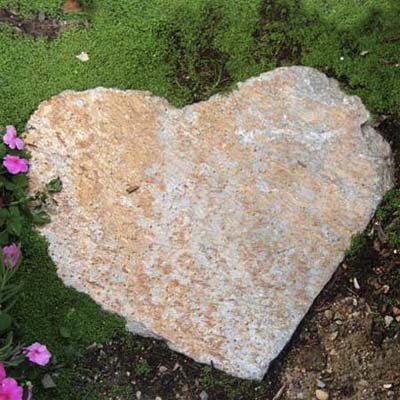 heart shaped stepping stone in yard