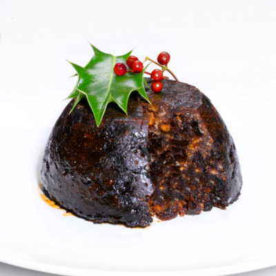 fruitcake topped with poisonous holly plant