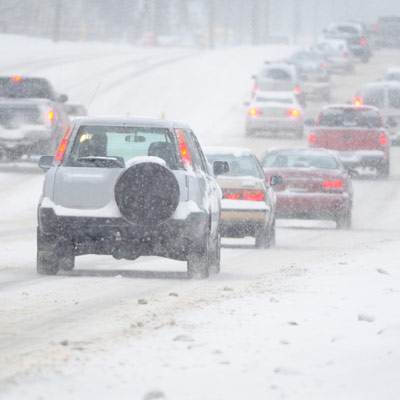 snowy roadway with holiday traffic and slippery driving conditions