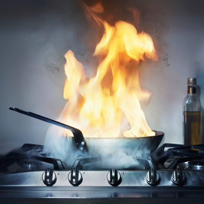 kitchen fire with pot on gas burner