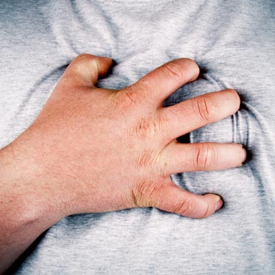 man clutching chest during heart attack