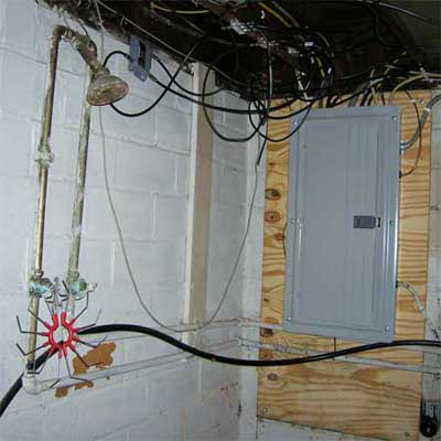working open shower installed less than three feet from a working electrical panel