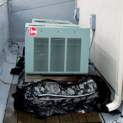 mattress folded under a compressor seen in home inspection