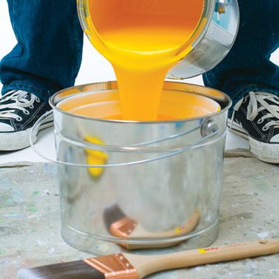 man disposing of paint