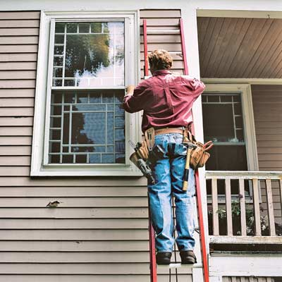 man working on extension ladder