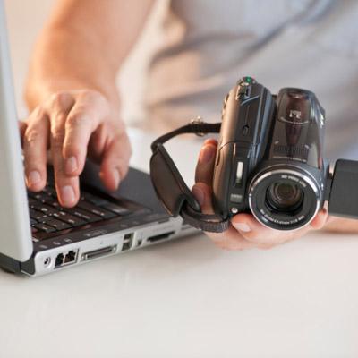 man videotaping house for insurance