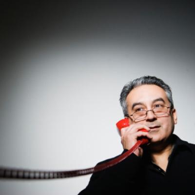 man using phone during blackout