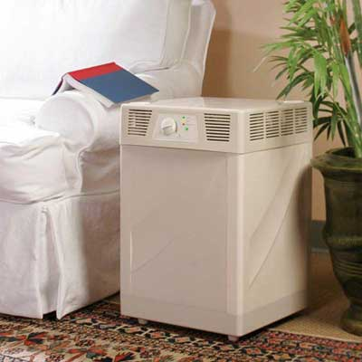 room air filter set between a couch and a potted plant