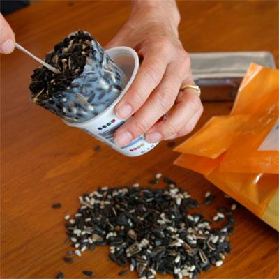 yogurt cups used to shape solid bird feed