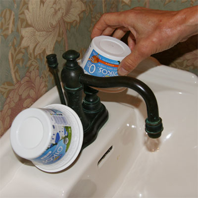 yogurt cups used to cover faucet handles