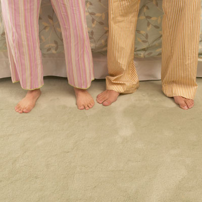 couple standing on carpet with bare feet